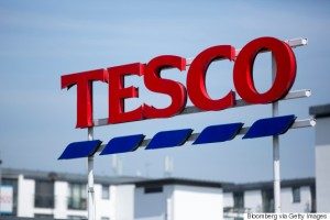 A Tesco logo stands on display outside a Tesco supermarket, operated by Tesco Plc, in London, U.K., on Monday, April 20, 2015. Tesco's April 22 results will serve as a reminder of the scale of the task still facing new Chief Executive Officer Dave Lewis after his decision to close dozens of stores, cancel some openings, consolidate head offices and cut prices on hundreds of branded goods. Photographer: Jason Alden/Bloomberg via Getty Images